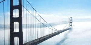 suspension bridge in low cloud